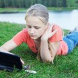 Girl with laptop outdoors — Stock Photo