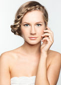 Portrait of young woman with braid hairdo — Stock Photo