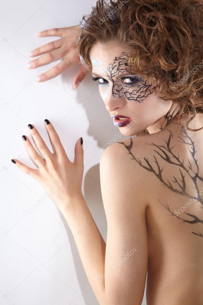 Portrait of beautiful model with skew bodyart and hairdo posing  — Stock Photo #13862976