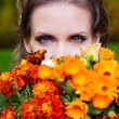 A beautiful brunette with flowers — Stock Photo #16890539