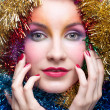 Woman in tinsel Christmas costume — Stok fotoğraf