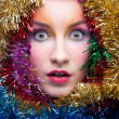 Woman in tinsel Christmas costume - Stockfoto