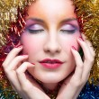 Royalty-Free Stock Photo: Woman in tinsel Christmas costume