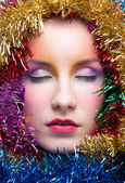Woman in tinsel Christmas costume — Stock Photo