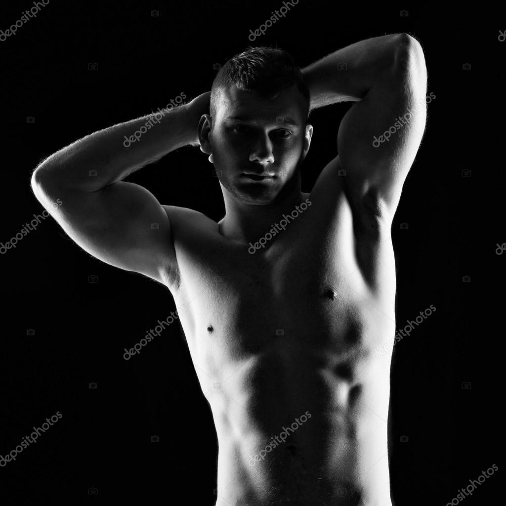 Silhouette of young athlete bodybuilder man on black  — Stock Photo #18929641