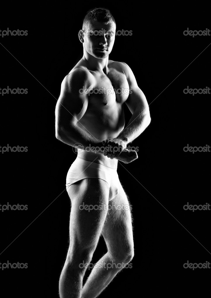 Silhouette of young athlete bodybuilder man on black  — Stock Photo #18929645