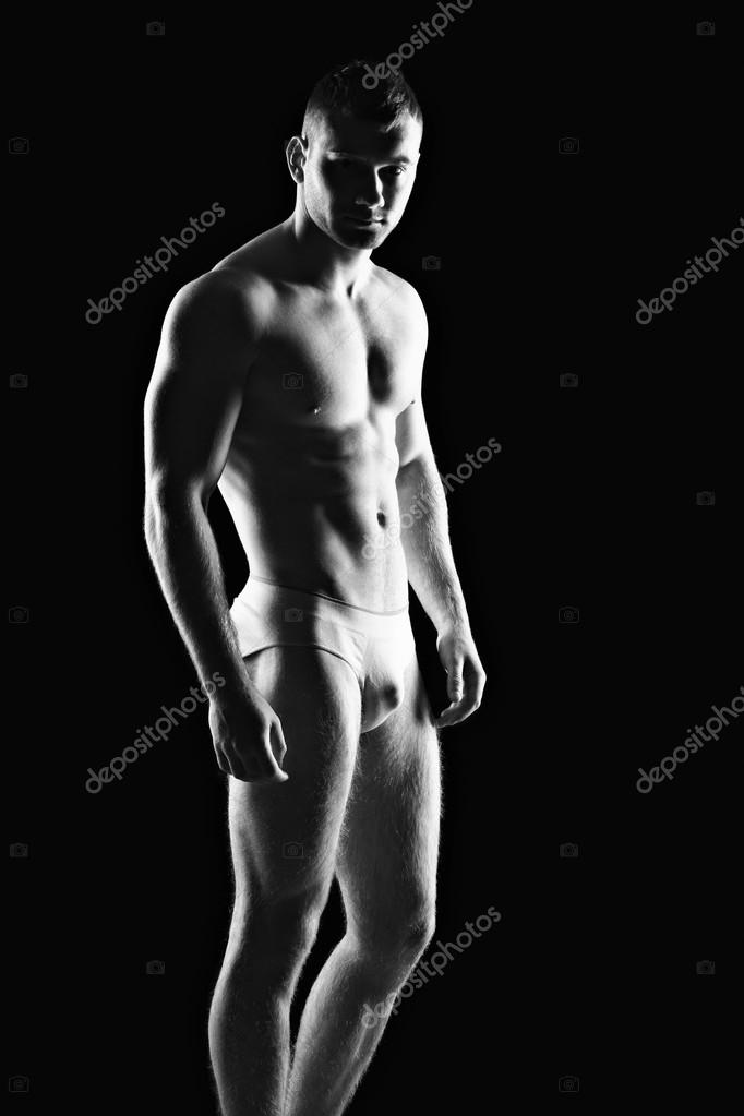 Silhouette of young athlete bodybuilder man on black   Stock Photo #18929649