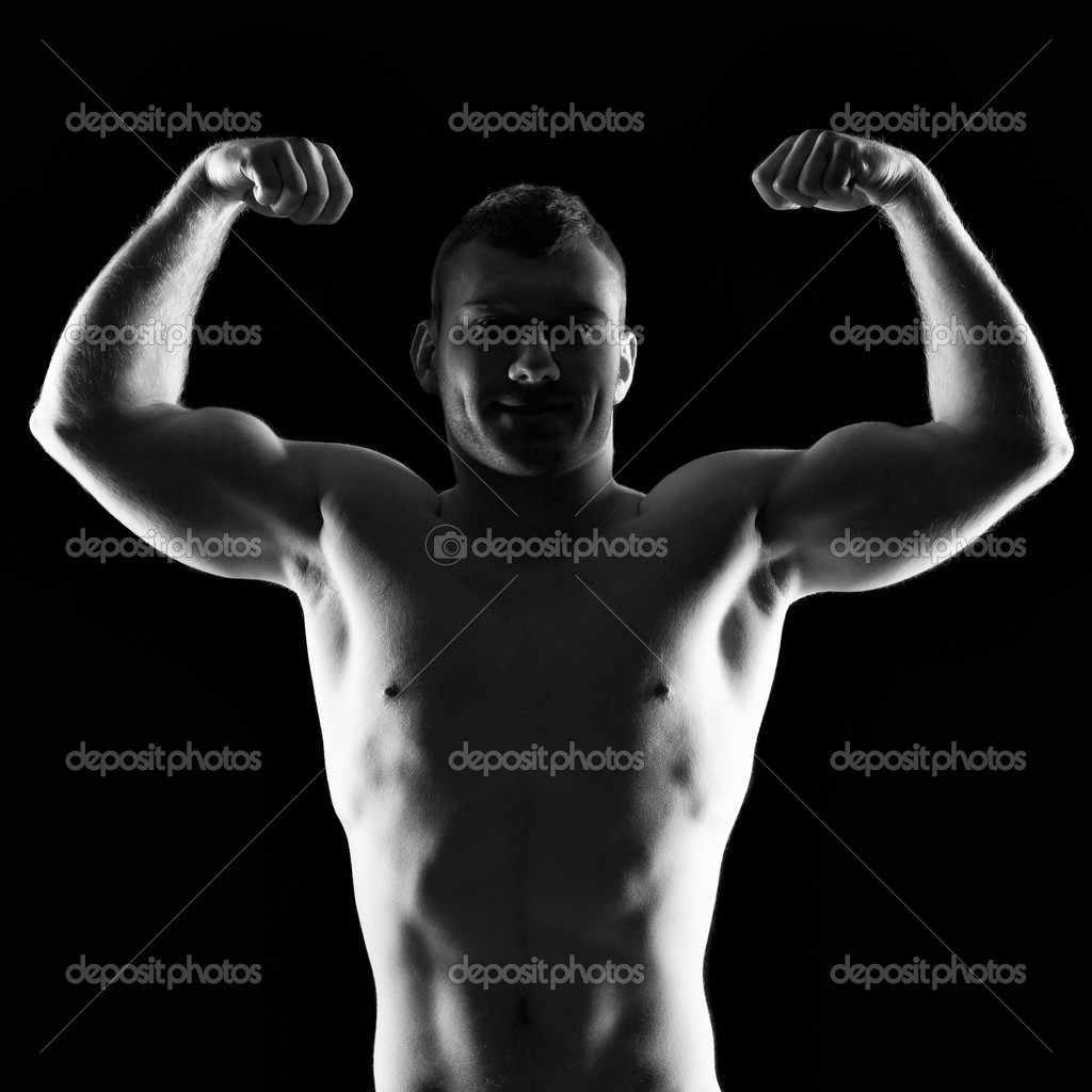 Silhouette of young athlete bodybuilder man on black   Stock Photo #18929651