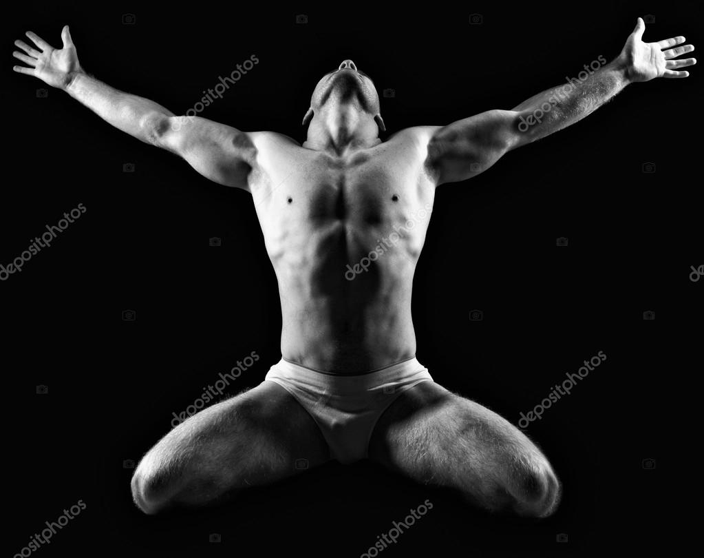 Silhouette of young athlete bodybuilder man on black  — Stok fotoğraf #18929681