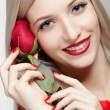 Blonde woman with rose - Stock Photo