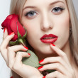 Blonde woman with rose — Stock Photo #19505909
