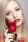 Blonde woman with rose — Stock Photo