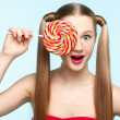Young woman with lollipop - Stock Photo