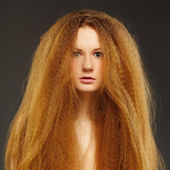 Beautiful curly red-haired woman — Stock Photo