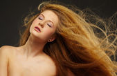 Long-haired curly red-haired woman — Stock Photo