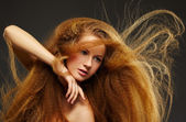 Long-haired curly redhead woman — Stock Photo