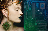 Beautiful woman with motherboard — Stock Photo