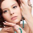 Woman with teal beads — Stock Photo #25058125