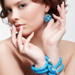 Woman with teal beads — Stok fotoğraf