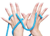 Isolated hands with beads — Stock Photo