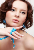 Woman with teal beads — Stock Photo