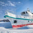 Ship in frozen baikal — Stock Photo