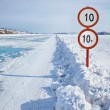 Traffic sign on Baikal ice - Stock Photo