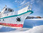 Ship in frozen baikal — Stock Photo