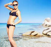 Bikini girl on the beach — Stock Photo