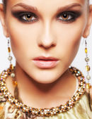 Beautiful woman in jewelry — Stock Photo
