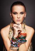 Beautiful woman in bracelets — Stock Photo