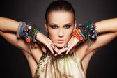 Beautiful woman in bracelets — Stock Photo