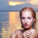 Beautiful blonde in sea — Stock Photo #31947869