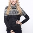 Blond women wearing casual grey knitted sweater and blue jeans — Stock Photo