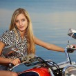 Blonde on red chopper — Stock Photo #3483094