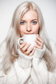 Blonde woman drinking a cap of tea — Stock Photo