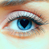 Heart in the pupil — Stock Photo