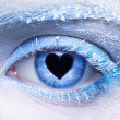 Frozen eye zone makeup and pupil in for of heart — Stock Photo
