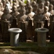 Stock Photo: Stone monks statues