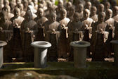 Stone monks statues — Stock Photo