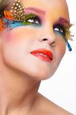 Woman with fashion feather eyelashes make-up — Stock Photo