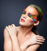 Woman with false feather eyelashes makeup — ストック写真