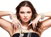 Beautiful young woman in necklace — Stock Photo