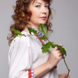 Folk woman with branch — Stock Photo #8741360