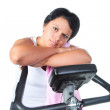Fat woman workout on the bicycle — Stock Photo #20190583