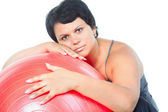 Fat woman with big red ball — Stock Photo