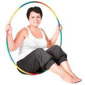 Mulher gorda com bambolê — Fotografia Stock