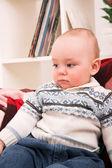 Boy sitting on sofa — Stock Photo