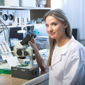 Researcher with microscope — Stock Photo