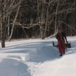 Beauty womwith dog in winter country — Stock Video #25553445